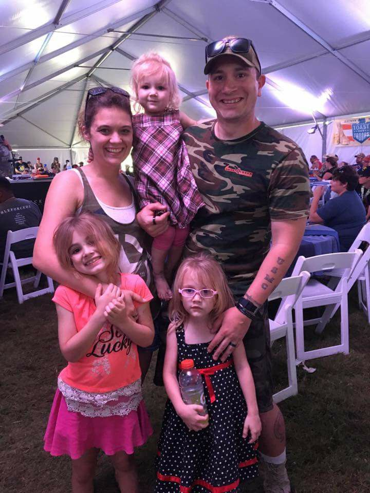 Kelsey with his family at the Redneck Tri 2017 Event