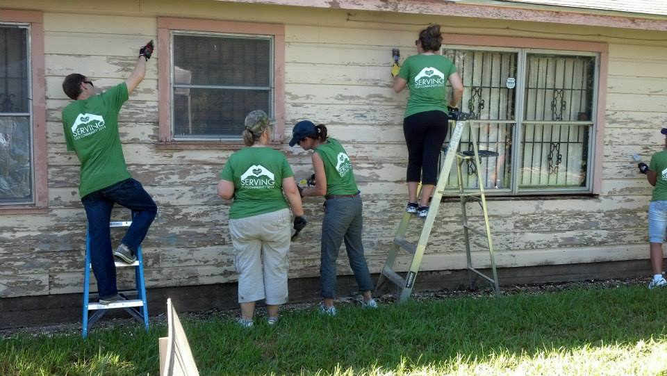 Camden Cares team repairing a home for a military family