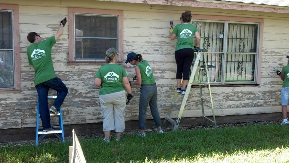Camden Cares team repairing a home for a military family
